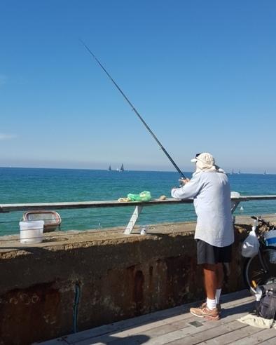 Fishing along Namal Tel Aviv