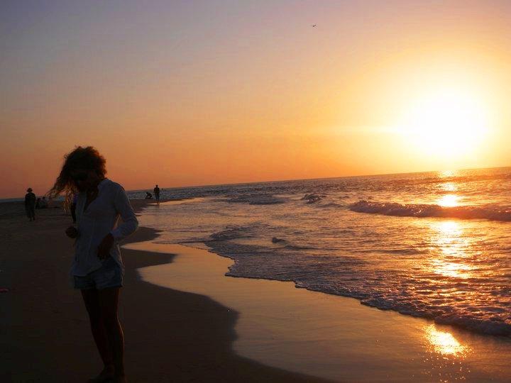 daniella and the sun setting tel aviv beach