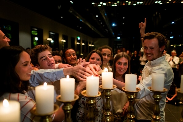 Candle lighting with friends at a Bar Mitzvah in Israel