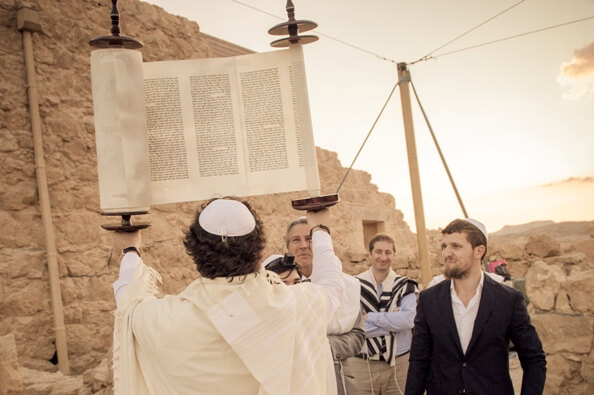 Bar Mitzvah in Israel holding a Torah