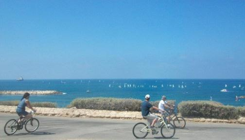 biking along the Tel Aviv Beach Promenade known as Hatayelet