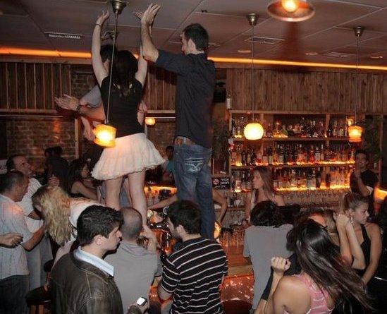 dancing on the bar at Mendelimos in Tel Aviv