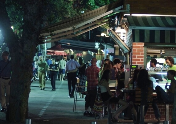 Walking in the evening along tree-lined Rothschild Boulevard in the heart of Tel Aviv