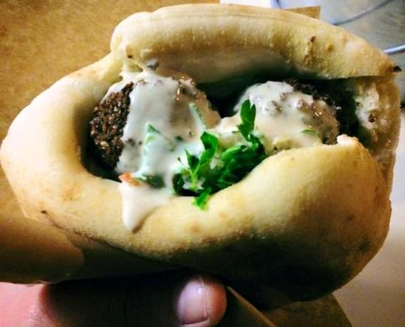fresh falafel balls in pita with tehina sauce and parsley
