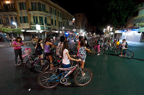 israel holidays - yom kippur kids bike on tel aviv streets day and night