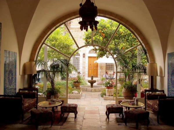 The American Colony hotel in East Jerusalem boasts antique furniture and combines Middle Eastern and Colonial-style decor