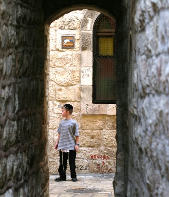 old city of Jerusalem young boy in cobbled corner