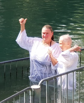 Laura and mother being baptised in the Jordan River on a Christian private tour of Israel