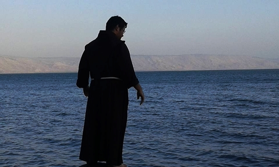 monk at Capernaum near the Sea of Galilee in Israel