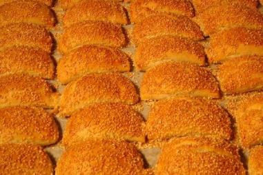trays of freshly baked burekas topped with sesame