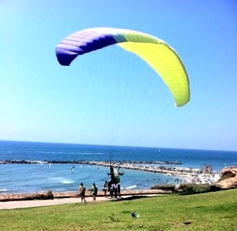 handgliding and surfing at the Hilton Tel Aviv beach