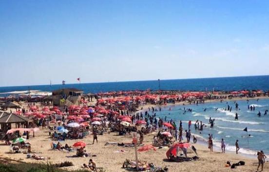 tel baruch beach in north tel aviv on a crowded summer weekend