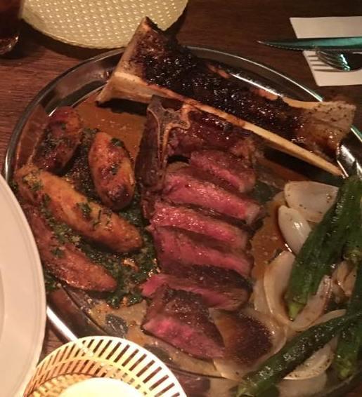 Jonathan Food Club steak with bone marrow, grilled potatoes, onions and okra