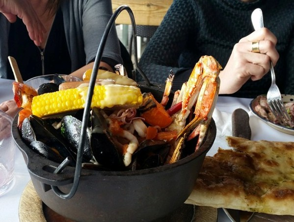 Manta Ray restaurant in Tel Aviv on the sea serves mixed seafood in a cast iron pot