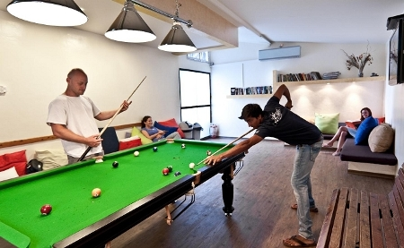 playing pool at 48 Hayarkon Hostel