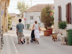 Tel Aviv Streets Family baby and dogs walking in Neve Tzedek village oasis