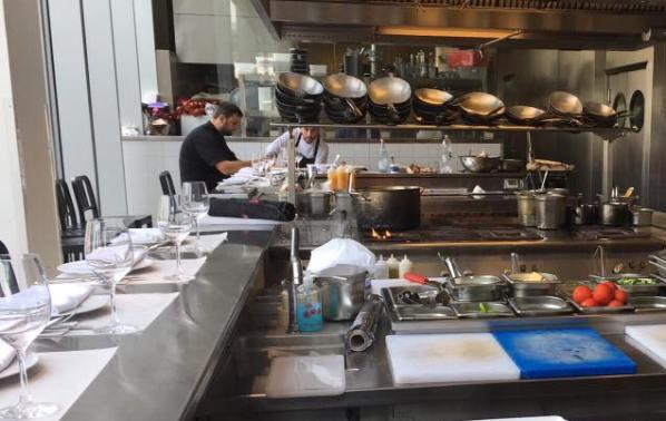 Dining at the kitchen bar at Yaffo Tel Aviv Restaurant