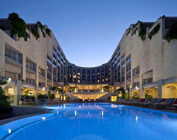 a night view of the Jerusalem David Citadel Hotel and pool