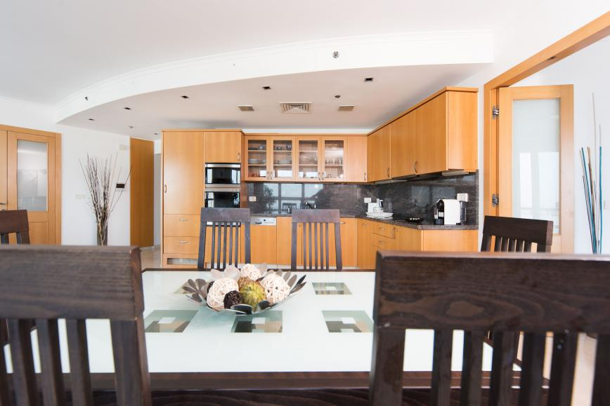 Luxury 2 bedroom Isrotel vacation apartment - kitchen and dining area