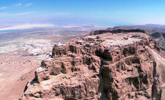 View of Masada Fortress in the Judean Desert with a veiw of the Dead Sea in the background