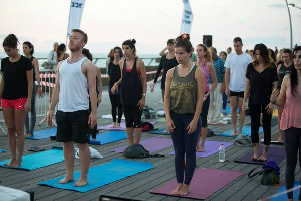Friday morning yoga class for free at the Tel Aviv Port